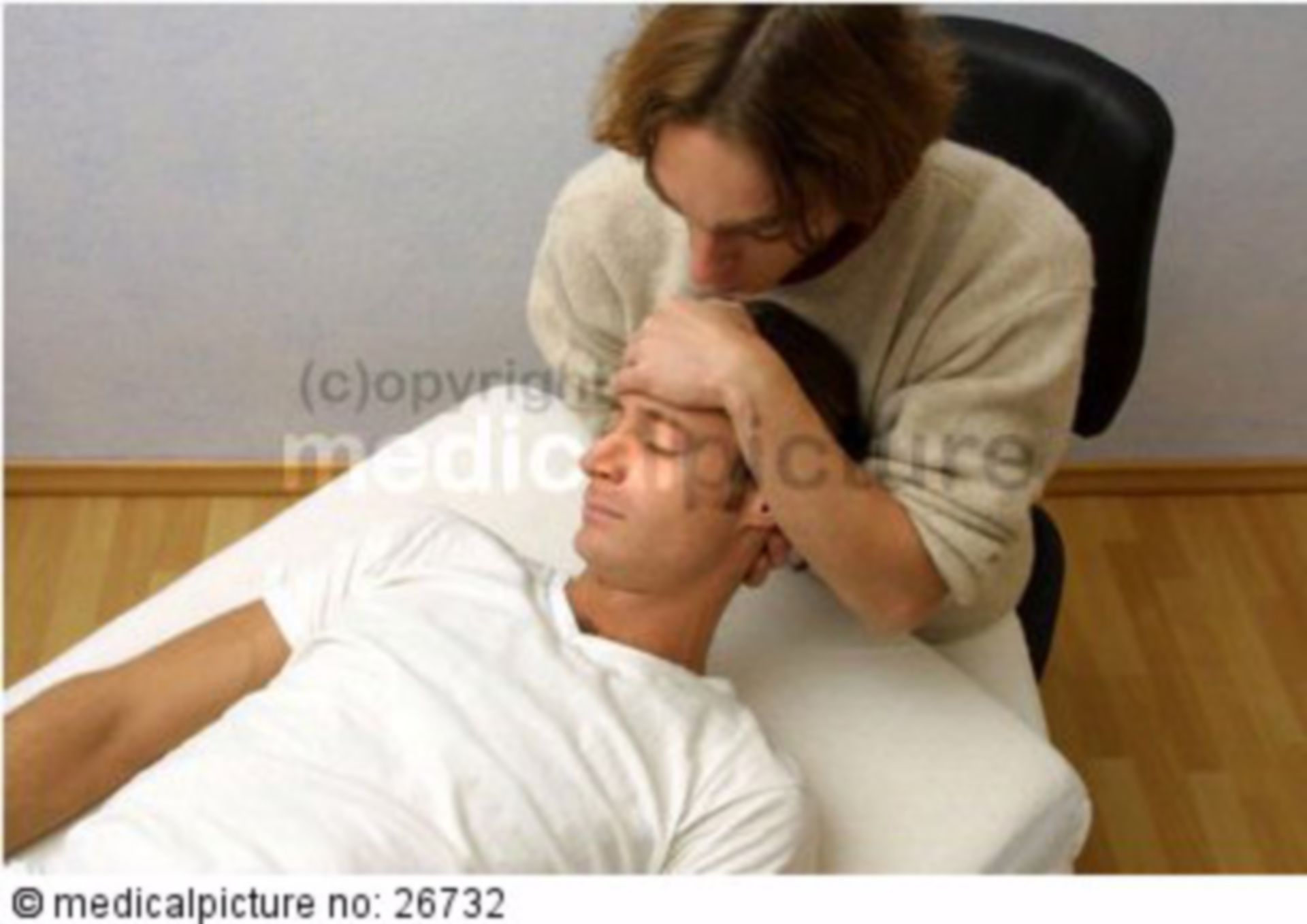 Osteopath with patient