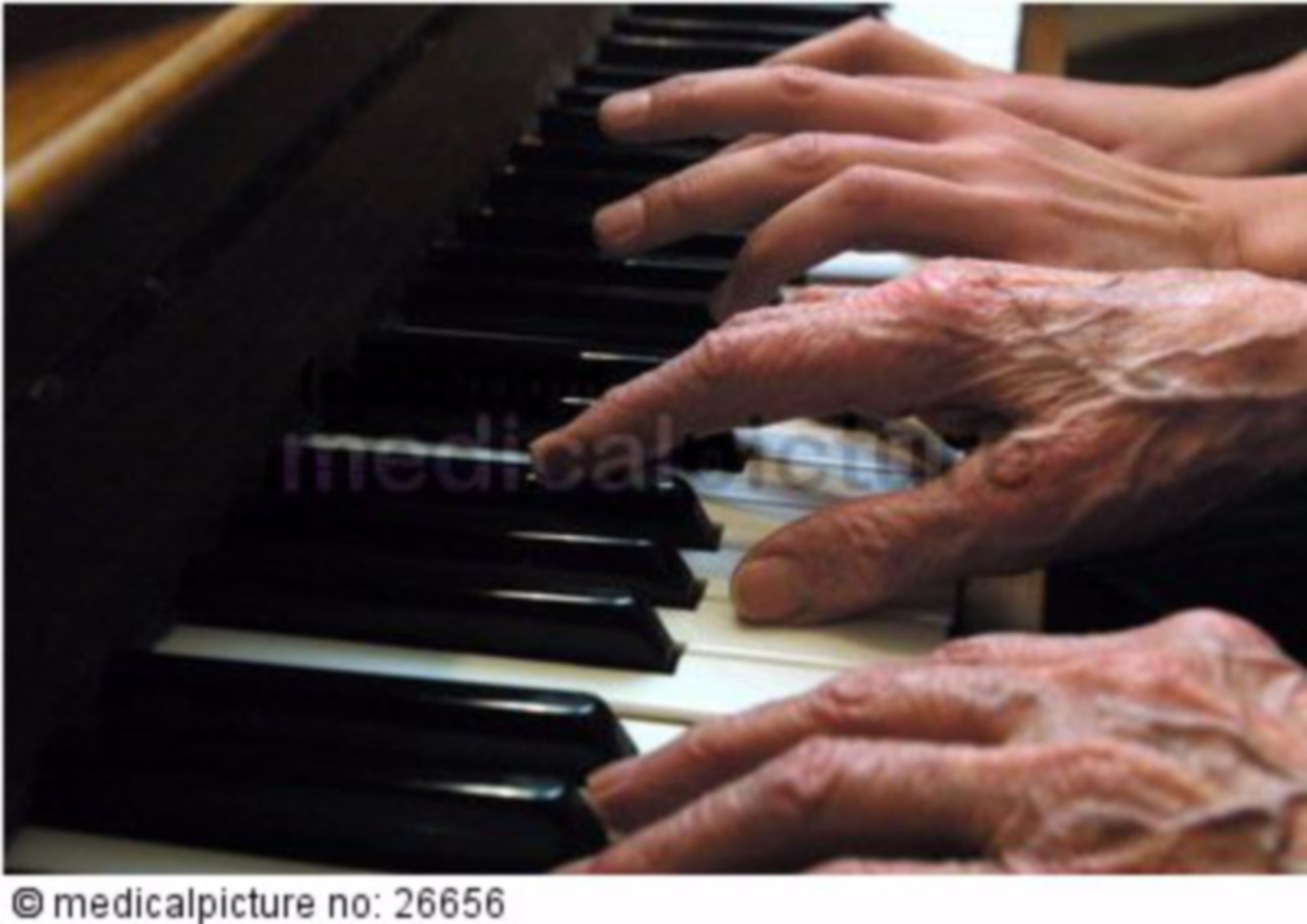 Old and young hands on a piano