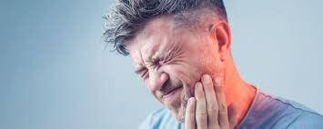 older_man_severe_tooth_pain_original.jpg